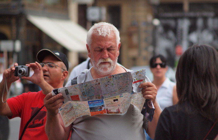 man reading map of Paris