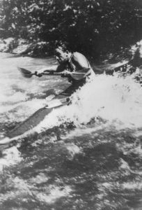 Walter Kirschbaum kayaking through a rapid on the Colorado River, 1960. Courtesy American Southwest Virtual Museum.